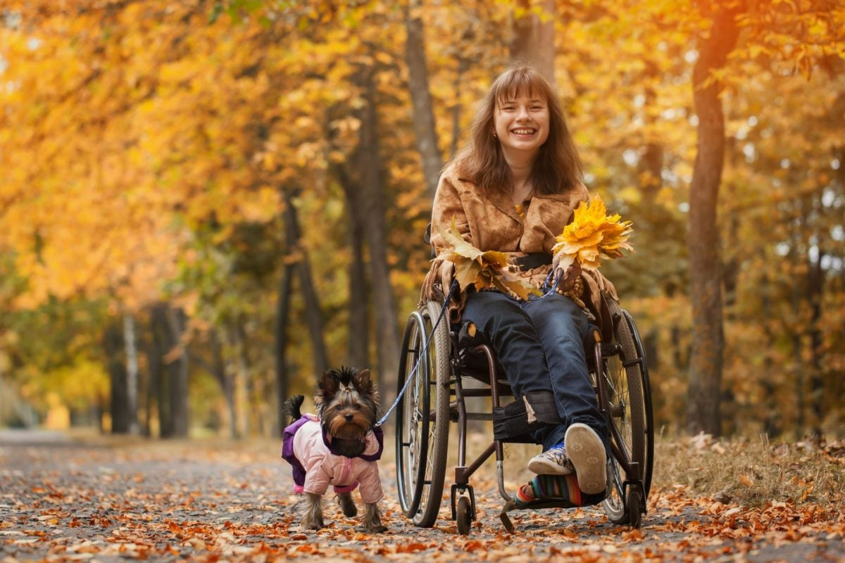 Women on Wheelchair with Dog